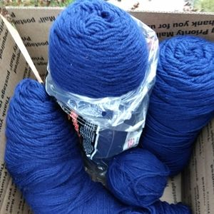Bundles of navy blue yarn